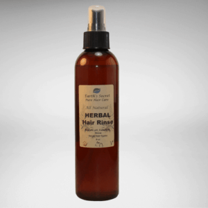 brown bottle with pump spray of natural herbal hair care rinse