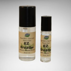 one-ounce and one-third-ounce rollon bottles of EZ Breathe Essential Oil