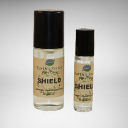 one-ounce and one-third-ounce rollon bottles of Shield Essential Oil