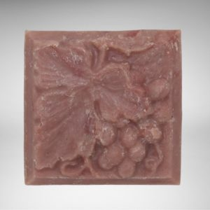 square bar of natural vegan sangria soap with grapes and leaf design