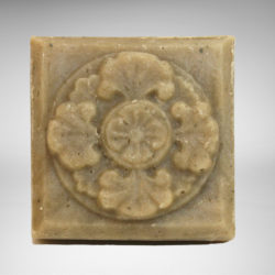 Square bar of Shield soap with floral design