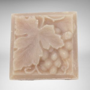 square bar of natural vegan white zinfandel soap with grapes and leaf design
