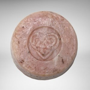 round pink-marbled soap with Celtic knot heart stamped in the middleikn